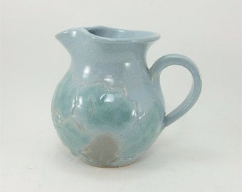 handmade small blue and green leafy pitcher or creamer