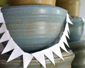 Solid white, or other solid color, fabric Cake Mini Bunting. Wooden Spool of Ribbon for gift wrapping and invitations.