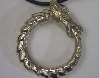 Polished Brass Dragon Ouroboros Pendant.