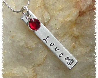 READY TO SHIP! Love with a Lady Bug Hand Stamped on a Silver Aluminum Rectangular Tag with a Red Swarovski Crystal Necklace