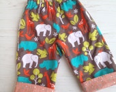 Flannel reversible pants, taupe and orange flannel safari animals sizes 6m-12m, 12m-18m, 18-24m, 3T