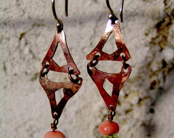 Swinging copper hinged earrings with peridot and pink coral beads.