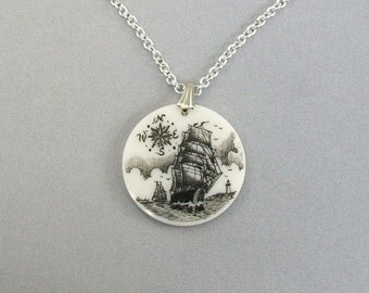 Scrimshaw Pendant with Ship Schooner Lighthouse and Compass Rose, Corian, nautical scene