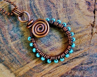 Antiqued Copper Wire Wrapped Spiral Pendant Necklace with aqua blue glass seed beads woven in