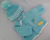 Hand knitted baby boy sweater aqua color with white trim and crocheted pom pom hat 0-5 months