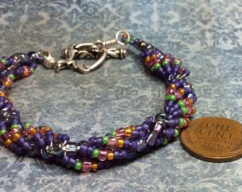 purple with a dash of green, pink, orange handmade spiral seed bead chain bracelet with sterling clasp