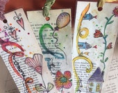 Laminated watercolor bookmarks on old book paper A, B, C