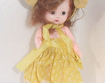 Doll - Hard Plastic Little Girl Doll -S & E  Co  - Original Dress - So Cute