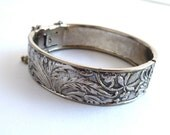 Silver tone bangle bracelet, floral embossed design, hinged closure with chain, FREE SHIPPING