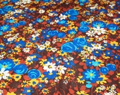 vintage 60s floral knit fabric featuring trippy blue, brown and gold styilzed design, 1 yard, 2 available priced PER YARD