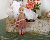 Antique German Dollhouse Bisque Flapper Doll in Pink and Green Dress