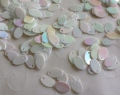 New item -- 7g of 8x5 mm Side Hole Oval Sequins in Opaque Iridescent Cream Color (approximately 780 ct.)