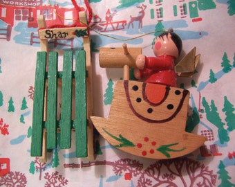 two little wooden holiday ornaments
