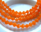 Vintage RARE Lucerna Beads ORANGE OPAL 6x6mm Bicone 6 inch strand 1970's (25) Almost transparent