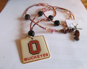 buck eyes necklace plus