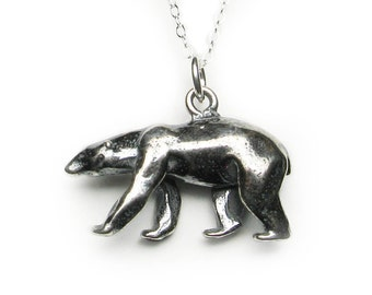 Solid sterling silver walking polar bear pendant or charm. Antique patina.