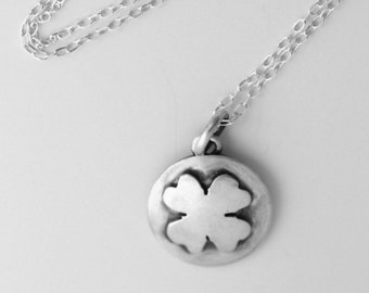 Small, dainty Sterling silver four leaf clover disc pendant handmade by Norita Designs