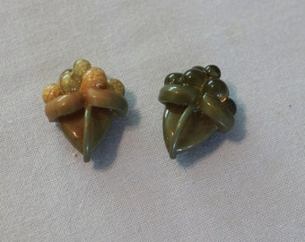 2 Vintage carved lucite buttons