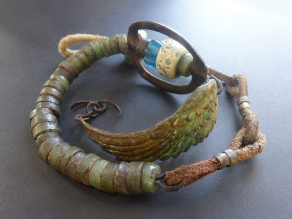 Ragnarök. Rustic double wrap assemblage bracelet with archeological dig find.