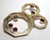 Octagon layered brooch with garnets