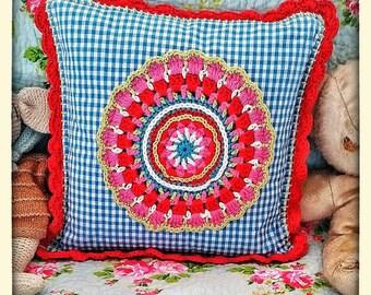 Handmade gingham cushion with crocheted mandala and trim