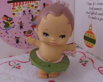 Adorable Vintage Tomy Wind Up Walking Baby w Jaundice