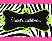 Add a single pair or regular shorts or ruffled shorts to your shirt or bodysuit order