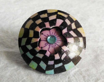 Hand drawn checkboard focal bead with hidden flower
