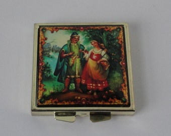 Courting Couple Gold tone metal double Compact Mirror.