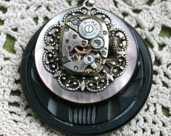 Steampunk Pendant with Vintage Buren Watch Movement Vintage Mother of Pearl Button Carved Black Celluloid Button
