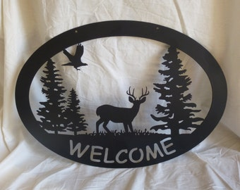 Deer and Eagle Welcome Sign
