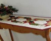 Red, Green, Tan and Cream Colored Winter Table Runner