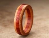 Size 13.25 - Orange Redheart Wood Ring