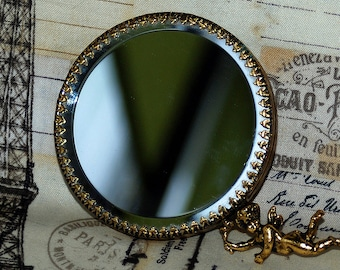 hand mirror... handle mirror with angel...  from an estate sale... Home Decor... Nov K