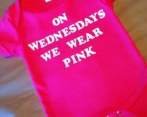 On Wednesdays We Wear Pink onesie Mean Girls inspired funny onesie for baby girl comes in vibrant pink which is shown or a light baby pink.