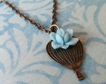 Up and Away. Hot Air Baloon Charm Necklace with Light Blue Rose. Antique Bronze Tone.