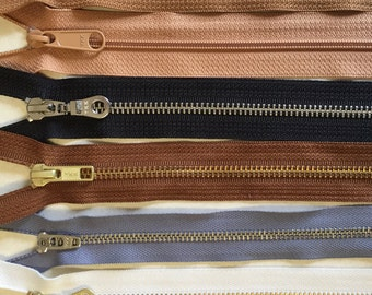 Zipper type sampler - metal, all-purpose, invisible, handbag zippers, gold and silver, antique brass, all in 9 inch size