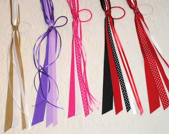 2 Pony Os in your choice of colors.  Ponytail Streamers made from grosgrain and satin ribbons.