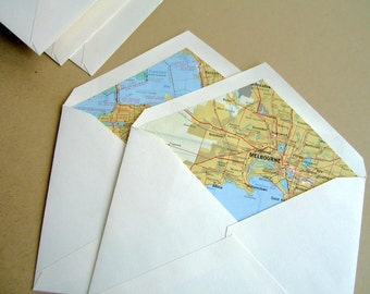 12 map lined envelopes.  Recycled 1960s maps of World Capitals for stationery and Travel art.