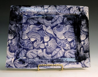 Ceramic and pottery porcelain serving tray with sea side images consisting of sea shells.