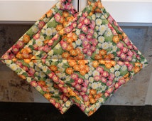 Pink and Orange and White Flower Bed Quilted Potholders or Hotpads
