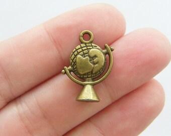 4 Globe charms antique bronze tone BC64