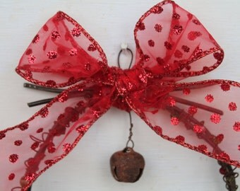 rustic Christmas ornament made from rusty barbed wire and rusted metal jingle bell