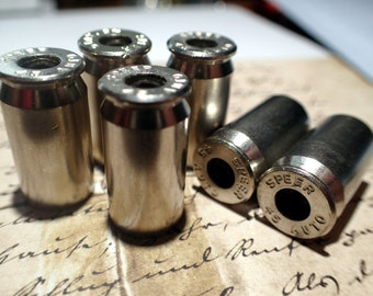 Bullet casings shells, 45 caliber nickel with primers removed! ready for crafting!