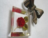 Vintage reverse carved Lucite flower pin brooch on metal bow