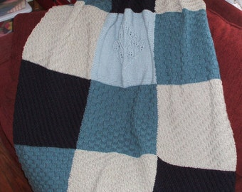 Hand knit afghan in blue and grey panels and in a soft and lovely 100 % Acrylic