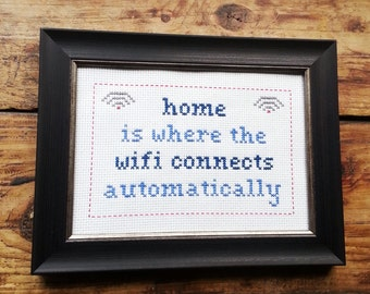 Home is Where the Wifi Connects Automatically cross stitch sampler in frame