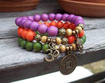 3 Stack Stretch Bracelets, Colorful Wooden Bracelets, Stretch Yoga bracelets, Om charm, Oriental Coin charm, Buddha charm bracelet, Hippie