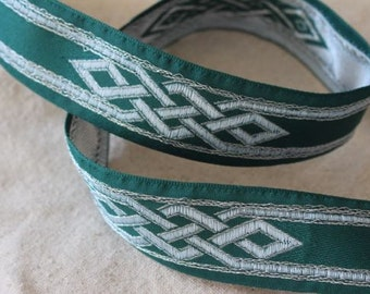 Jacquard ribbon trim in light BLUE and SILVER on Forest GREEN