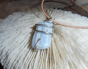 White Cliffs- This Spiral Seed Pendant features a polished piece of Blue Lace Agate that is Spiral wrapped in Silver.